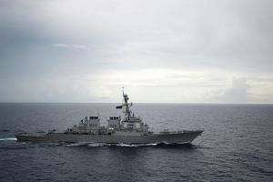 File photo of the guided-missile destroyer USS Decatur (DDG 73) operating in the South China Sea as part of the Bonhomme Richard Expeditionary Strike Group on Oct 21, 2016.