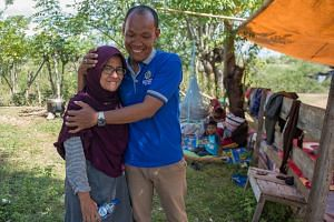Mr Azwan found his wife Dewi alive and well after she was swept away in the tsunami that crashed into the Indonesian city of Palu.