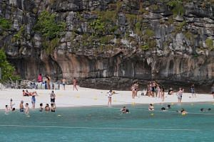 Tourists pass their time as they visit Maya bay at Krabi province, Thailand. PHOTO: REUTERS