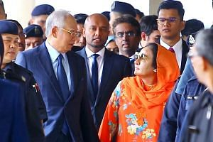 Datin Seri Rosmah Mansor and Datuk Seri Najib Tun Razak walk out of the court after she was charged with money laundering and tax evasion, on Oct 4, 2018.