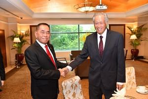 Defence Minister Ng Eng Hen with Indonesian Defence Minister Ryamizard Ryacudu on the sidelines of the 2018 Southeast Asia Counter-terrorism Symposium.