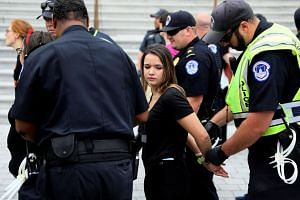 US Capitol police arrest protesters from the steps of the Capitol.