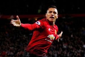 Manchester United's Alexis Sanchez celebrates scoring their third goal.