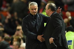 Mourinho (left) and Newcastle United's Spanish manager Rafael Benitez shake hands after the match.