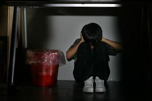 Posed photo showing a child covering his ears while looking down. Child abuse is often not just about physical violence, it can also include emotional abuse, sexual abuse and neglect.