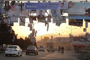 Campaign posters of candidates for the upcoming parliamentary election are installed on a light pole in downtown Kabul, Afghanistan, on Oct 6, 2018. The Taleban has repeatedly rejected offers to hold peace talks or support the polls.