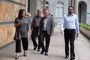 (From left) Workers' Party's Sylvia Lim, Png Eng Huat, Low Thia Khiang and Pritam Singh at the Supreme Court on Monday. The WP's lawyer had explained that directly managing a town council would take up much of an MP's time.