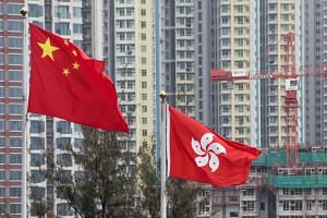 Flags of China (left) and Hong Kong fluttering in front of a residential building at the former Kai Tak airport area in Hong Kong, on May 26, 2017.