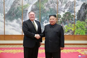 US Secretary of State Mike Pompeo shaking hands with North Korean leader Kim Jong Un during their meeting in Pyongyang, North Korea, on Oct 7, 2018.