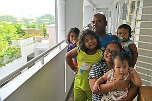 Ms Nuraini Jamalludin with her husband Yusran Asip, 43, and children (clockwise from front) Mohamad Solihan, one, Nur Ar'yani, five, Nur Ar'yana, three, and Mohamad Solihin, two, at their home. ST interviewed 20 residents of rental blocks integrated