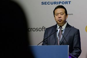File photo of Meng Hongwei, president of Interpol, giving an address at the opening of the Interpol World Congress in Singapore.