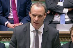 Dominic Raab addressing MPs at the House of Commons in Londom.