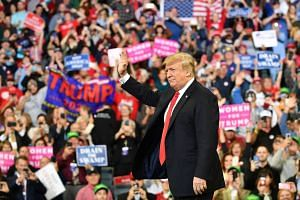 """US President Donald Trump at a rally in Iowa on Oct 9, 2018. He told attendees that what Democrats did to Justice Brett Kavanaugh was """"a national embarrassment and national disgrace""""."""