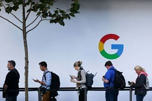People wait to enter a Google product launch event in San Francisco, California.