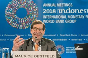 IMF chief economist Maurice Obstfeld answering questions during the World Economic Outlook press conference at the 2018 IMF/World Bank annual meetings in Nusa Dua.