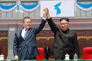 South Korean President Moon Jae-in and North Korean leader Kim Jong Un gesturing during a 'mass games' gymnastic and artistic performance at the May Day Stadium in Pyongyang, on Sept 19, 2018.