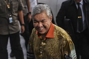 Former Malaysian deputy prime minister Ahmad Zahid Hamidi arrives at the Malaysia Anti-Corruption Commission in Putrajaya on Oct 10, 2018.