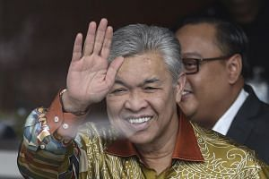 Former Malaysian Deputy Prime Minister Zahid Hamidi waves to the press as he arrives at the Malaysia Anti-Corruption Commission in Putrajaya, Malaysia, on Oct 10, 2018.