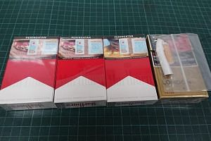 Follow-up checks at the man's workplace and residence uncovered a total of three packets and 10 sticks of contraband cigarettes belonging to him.