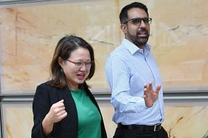 Workers' Party chairman Sylvia Lim and secretary-general Pritam Singh outside the Supreme Court building on Oct 12, 2018.