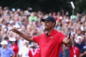 Former world No. 1 Tiger Woods celebrating his par putt on the 18th green to win the Tour Championship at East Lake Golf Club in Atlanta, Georgia last month. Among his next targets will be to win a 15th Major.