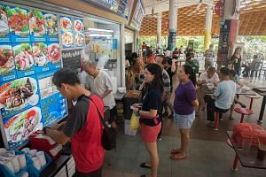 The lunchtime crowd at Pasir Ris Central Hawker Centre, one of the new centres managed by private social enterprises and cooperatives. Footfall is a key consideration among hawkers at the centres under the new model. Some hawkers at the Jurong West H
