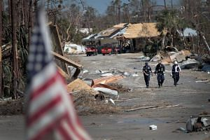 Search and rescue team members search for victims of Hurricane Michael, on Oct 13, 2018 in Mexico Beach, Florida.