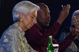 """International Monetary Fund chief Christine Lagarde said she intends to go ahead with attending the conference, and """"to be very attentive to the information that is coming out in the next few days""""."""