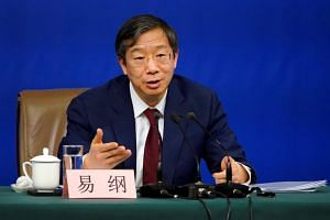 China's central bank Governor Yi Gang said the country will step up reforms and open up its economy further.