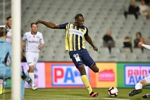 Olympic sprinter Usain Bolt takes a shot on goal against Macarthur South West United in his first competitive start for the Central Coast Mariners, in Sydney, on Oct 12, 2018.