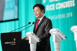 Minister for National Development Lawrence Wong giving his opening address at the 5th International Rice Congress at Marina Bay Sands, on Oct 15, 2018.