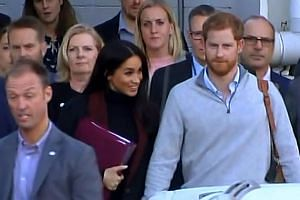 Prince Harry and wife Meghan Markle after landing in Sydney yesterday for their first official royal tour.