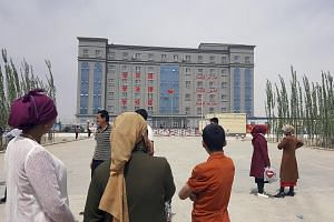 """An undated handout photo of an indoctrination camp in Hotan, China. Hundreds of thousands of Uighurs and other Muslim minorities have been held in such """"transformation""""camps across Xinjiang for weeks or months at a time, according to former inmates a"""