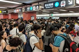 Commuters waiting to board an MTR train at Wan Chai station. A signalling system fault caused delays to Hong Kong's metro stations on Oct 16, 2018.