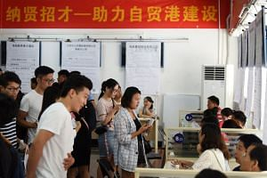 A job fair at the Human Resources Development Bureau of Hainan province. Chinese President Xi Jinping had said in April 2018 that China would set up a free trade pilot zone and build an international free trade port in Hainan.
