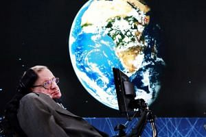 Physicist Stephen Hawking sits on stage during an announcement of the Breakthrough Starshot initiative in New York, on April 12, 2016.