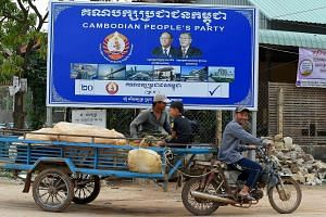 A Cambodian People's Party billboard showing Prime Minister Hun Sen (right) and National Assembly president Heng Samrin. While Mr Hun Sen may be keen to move on to the post-election phase, his pre-election crackdown is not that easily forgotten by ot