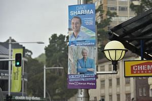 Election posters of Liberal candidate Dave Sharma and independent candidate Kerryn Phelps are seen on a street in the seat of Wentworth in Sydney on Oct 18, 2018.