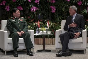 Defence Minister Ng Eng Hen meets Vietnamese Minister of National Defence Ngo Xuan Lich at the Shangri-La Hotel in Singapore on Oct 18, 2018, ahead of the 12th Asean Defence Ministers' Meeting.