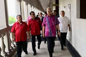 Malaysia's former prime minister Najib Razak walked into the court room just before the charges were read out on Oct 19, 2018.