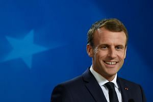 Macron addresses a press conference on the sidelines of an EU summit on Oct 18, 2018.