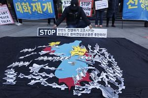 South Koreans protest during a rally in front of the US embassy in Seoul on Dec 4, 2017, to show opposition to joint South Korea-US Air-force exercises.