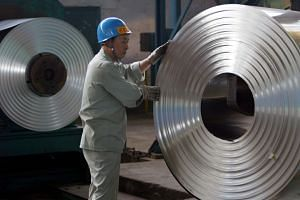 The US has said the tariffs on imported steel and aluminium imposed earlier this year are allowed under the WTO's national security exemption.