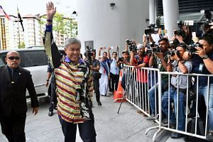 Former Malaysian deputy prime minister Ahmad Zahid Hamidi arriving at the Malaysian Anti-Corruption Commission headquarters yesterday, where he was arrested. Some of the charges the Umno president is set to face are related to his family-run welfare