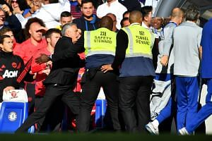 Mourinho reacts to Chelsea assistant coach Marco Ianni after Chelsea's second goal.