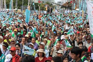 The protest in central Taipei, Taiwan, came as China increasingly pushes its claim to the self-ruling democratic island.
