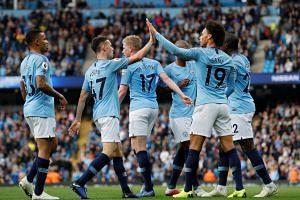 City's Leroy Sane celebrates scoring their fifth goal with team mates.