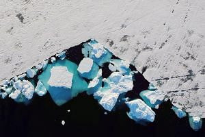 A glacier's collapse in Greenland shows the impact of climate change. The Arctic could see ice-free summers at least once every decade in a 2 deg C world, versus once in a century at 1.5 deg C.