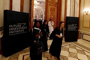 Participants enter the Future Investment Initiative conference in Riyadh, Saudi Arabia, on Oct 24, 2017.