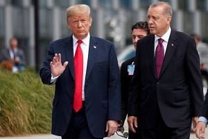 File photo of US President Donald Trump and Turkish President Tayyip Erdogan at the Nato summit in Brussels, Belgium, on July 11, 2018.